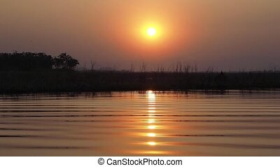 golden hour sunset in lake background