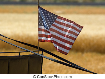 A small US flag sits on part of a wagon