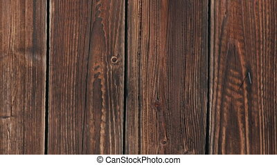 Panning shot of brown wooden fence texture for background macro front