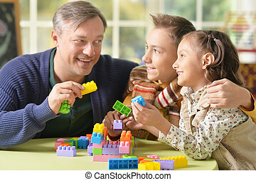 family playing constructor - Portrait of a family playing...