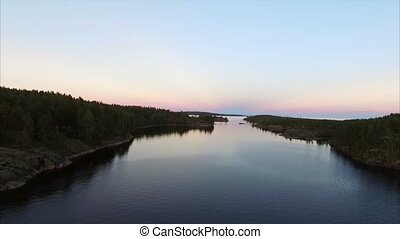 Unrecognizable people in boat at evening aerial shot