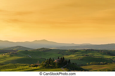 Farmhouse, green hills,cypress trees in Tuscany at sunrise