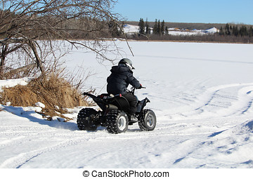 Child Driving His Quad Onto a Frozen Lake