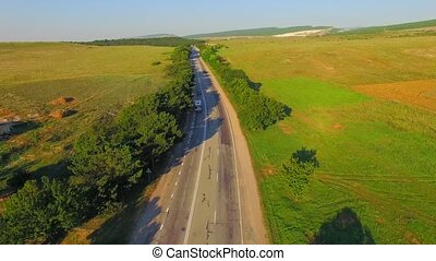 AERIAL VIEW. Track With Driving Cars Between Farm Fields -...