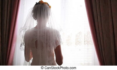 Bride looks out of the window