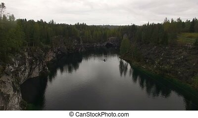Aerial shot of Ruskeala mining park lake 4k