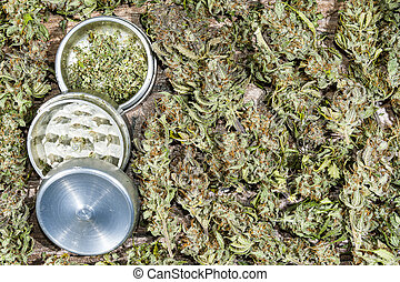 Metal grinder with cannabis buds - Open aluminum metal...