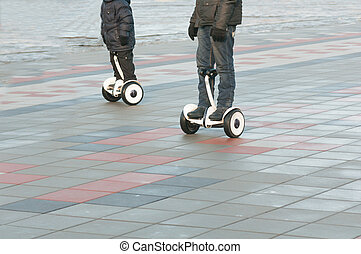 father and son ride on a Segway
