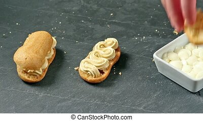 Frosting two eclairs
