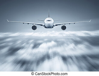 airliner flying over the clouds