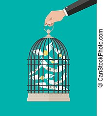 Hand holds cage with flying money. Investment and savings....