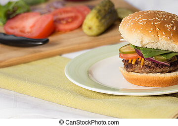 Cheeseburger Sesame Seed Bun - Cheeseburger on a sesame seed...