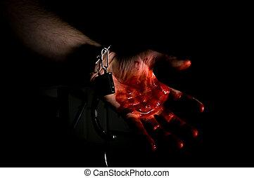 Murderer Bloody Hand - Bloody murderers hand in handcuffs in...