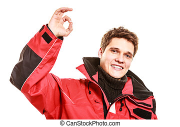 Male outdoorsman making gestures. Young man with...