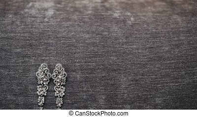 Beautiful earrings on gray background shot