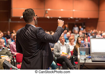 Public speaker giving talk at Business Event. - Speaker...