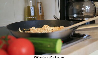 Frying egg in a pan - Fried Eggs In Frying Pan With Tomatoes...