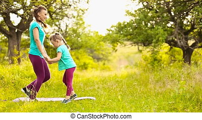Mom with a child involved in fitness in nature
