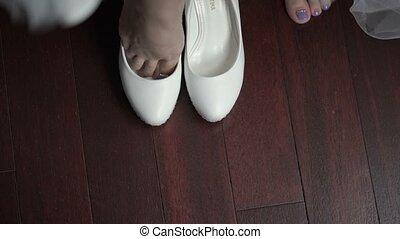 Bride wearing shoes closeup shot