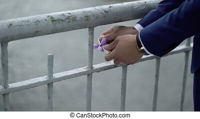 Bride and groom with padlock shot