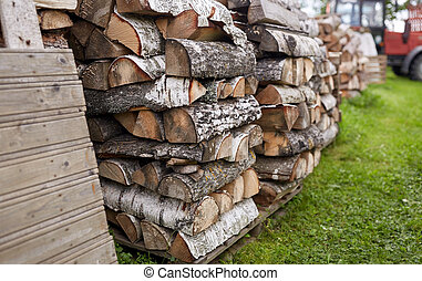 stack of firewood on farm at country - heating, agriculture...
