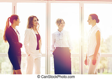 business women meeting at office and talking - people, work...