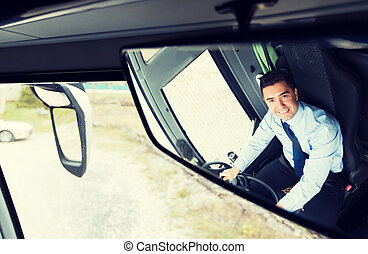 close up of driver reflection in bus mirror - transport,...