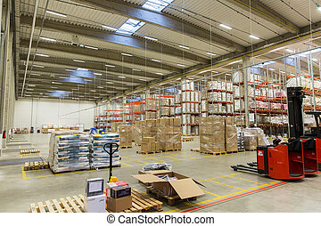 forklift loader and cargo boxes at warehouse