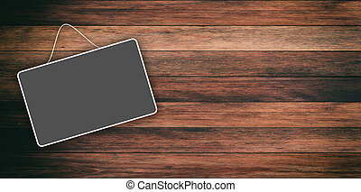 Grey sign hanging on wooden background