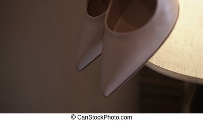 Woman shoes on lamp shot