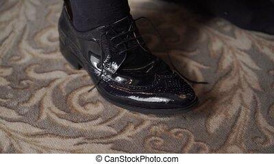Man wearing shoes closeup shot