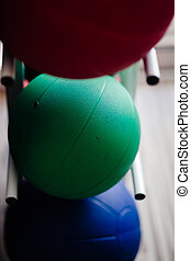 cardio ball in gym. Greeen fit balls