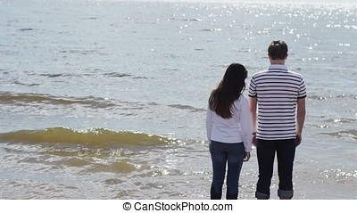 Young lovely couple embracing on a beach shot