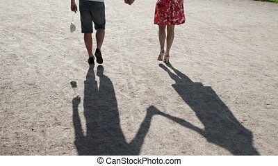 Young lovely couple walks in park