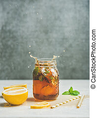 Summer Iced tea with lemon and herbs, copy space - Summer...