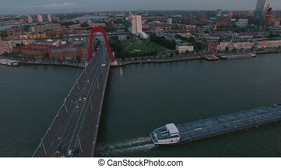 Aerial waterside view of Rotterdam with Willem Bridge -...