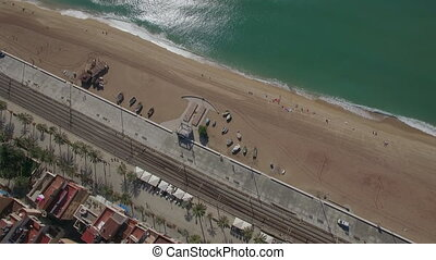 Aerial top view of beach, sea, railways and hotels,...