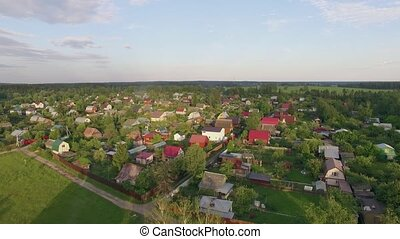 Aerial shot of village, highway and green nature in Russia -...