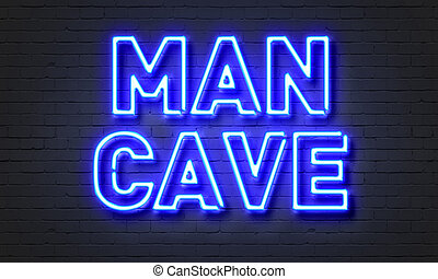 Man cave neon sign on brick wall background. - Man cave neon...
