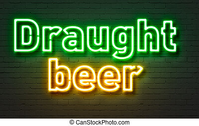 Draught beer neon sign on brick wall background.