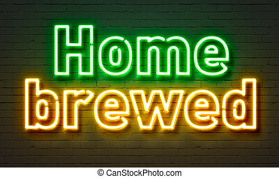Home brewed neon sign on brick wall background.