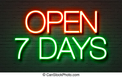 Open 7 days neon sign on brick wall background. - Open 7...