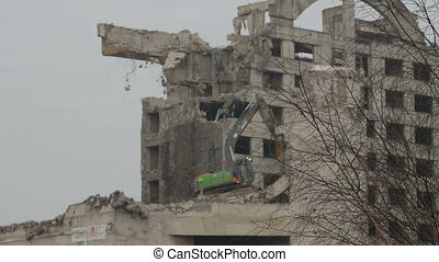 Building demolition with hydraulic excavator, Lithuania,...