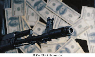 gun and money. the concept of the sale of weapons. wage the...