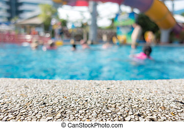 Swimming pool side rock surface for backdrop