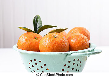 Mandarin Oranges in Colander - Closeup of a colander filled...
