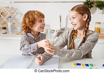 Adorable little kid offering his sister milk - Would you...