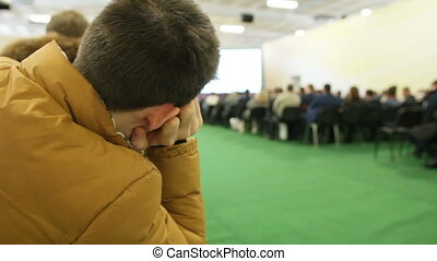 Presentation for audience - listener feels bored during high technology agricultural seminar