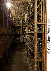 a wine cellar with bottles - a lot of old wine bottles in...