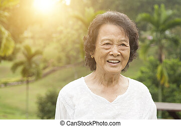 Happy Asian seniors woman laughing at outdoor